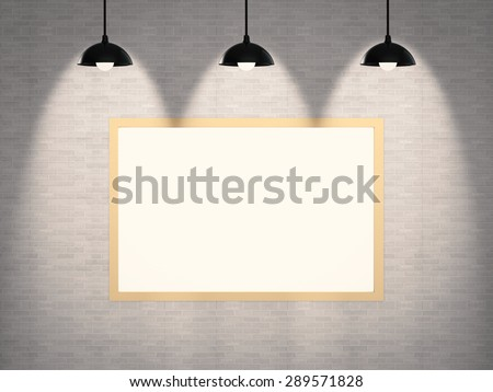 blank frame on wall  with hanging lamps - stock photo