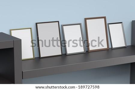 blank frames leaned against wall - stock photo
