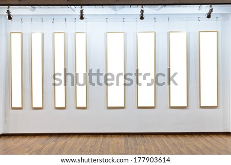 Blank frames on the wall at art museum - stock photo