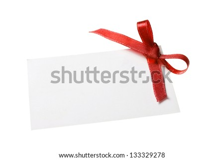 Blank gift tag tied with a bow of red satin ribbon. Isolated on white, with soft shadow - stock photo