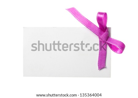 Blank gift tag tied with a bow of satin ribbon. Isolated on white, with soft shadow