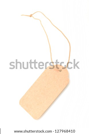 Blank gift tag tied with string to write own message - stock photo