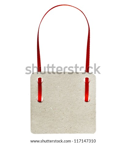 Blank gift tag with a red ribbon tape, isolated on white background - stock photo