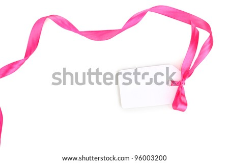 Blank gift tag with pink satin bow and ribbon isolated on white - stock photo