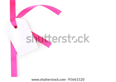 Blank gift tag with pink satin ribbon isolated on white - stock photo