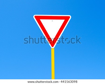 Blank give way sign on clear blue sky background (with clipping path)