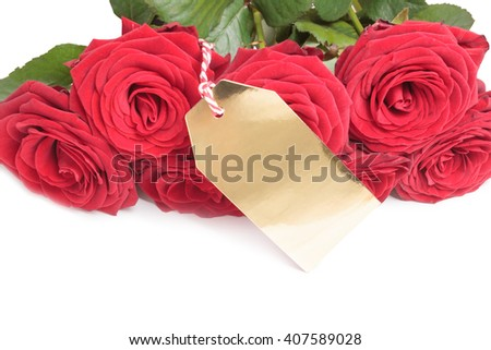 Blank golden tag with red roses isolated on white background - stock photo