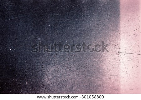 Blank grained film strip texture background with heavy grain, dust, scratches and light leak