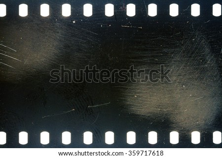 Blank grained scratched film strip texture background
