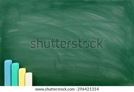 Blank green chalkboard, school board background with chalk - stock photo
