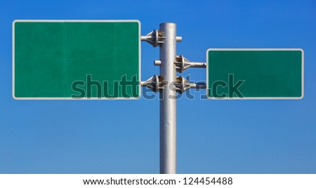 Blank green road sign board on blue sky - stock photo