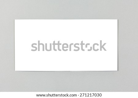 Blank greeting card on blue background