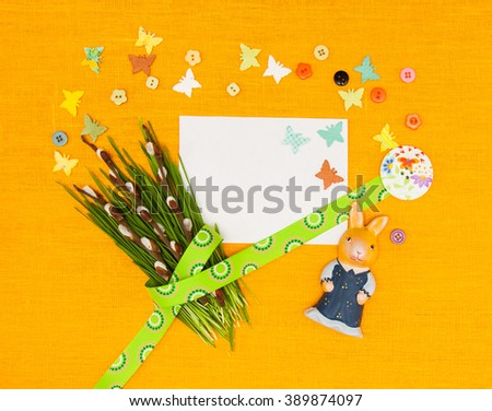Blank, greeting easter card with easter eggs,butterflies,bunny and green grass in yellow textile background