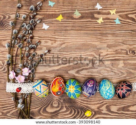 Blank, greeting easter card with handmade easter eggs, catkins,vine in wooden background - stock photo