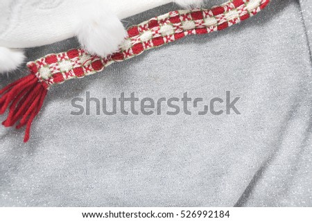 Blank grey background with glitter for copyspace decorated with christmas scarf