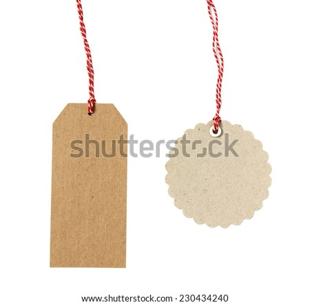 Blank hanging gift tags made from brown eco-friendly kraft paper in different shapes with red twine - isolated on white background - stock photo