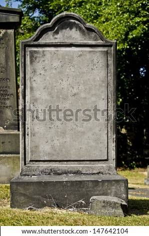 blank headstone in a cemetery - stock photo