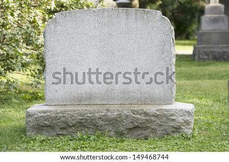 Blank headstone in cemetery - stock photo