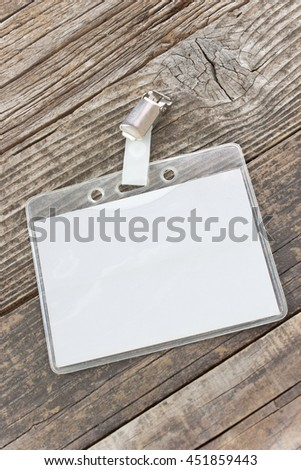 Blank ID card tag on wooden background
