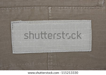 Blank jeans label. Fragment of jeans with pure label for your text. - stock photo