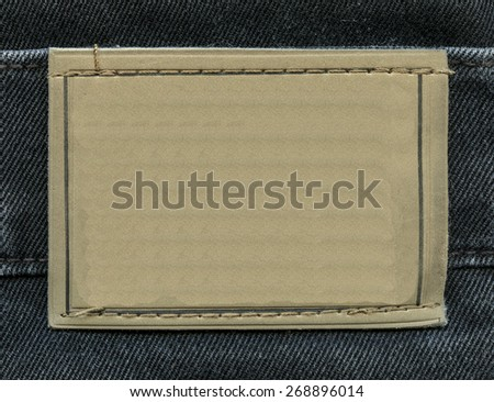 blank jeans label on denim background