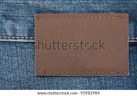 Blank jeans label sewed on a blue jeans