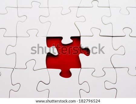 blank jigsaw puzzle missing piece - stock photo