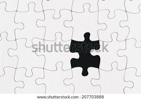blank jigsaw puzzle with one missing piece - stock photo