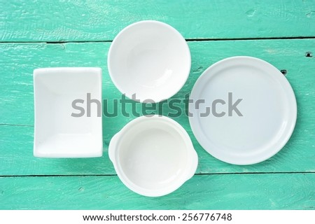 Blank Kitchenware on wood table. - stock photo