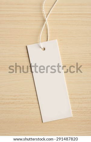 Blank label is on the wooden textured background. - stock photo