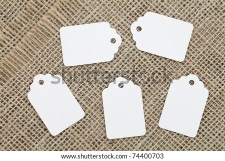 Blank label on burlap background - stock photo