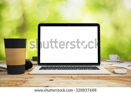 Blank laptop and black cup of coffee on the wooden table outdoors, mock up - stock photo