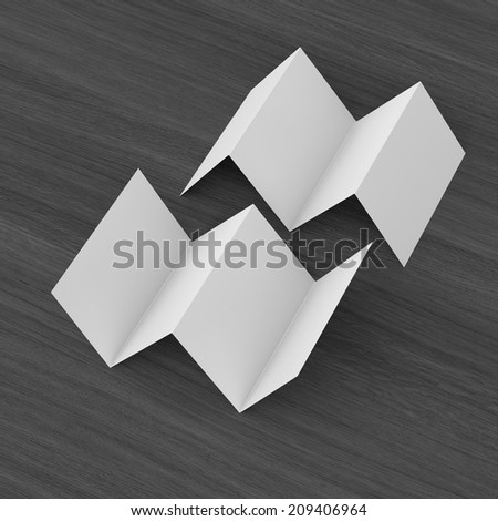 blank leaflets with four wings isolated on wooden table. render - stock photo