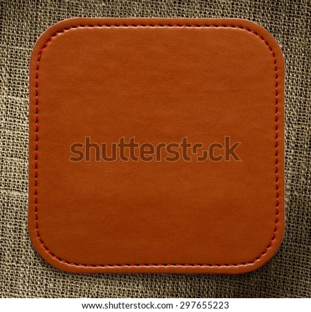 Blank leather brown label on sack background