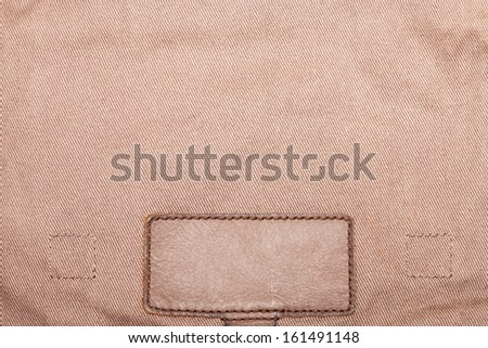 Blank leather jeans label, isolated, decorated - stock photo