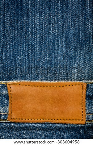 Blank leather jeans label on a blue jeans texture - stock photo