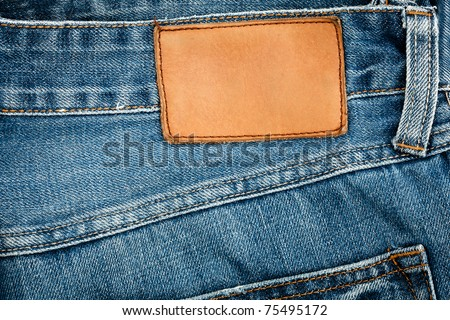 Blank leather jeans label sewed on a blue jeans. - stock photo