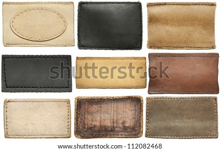 Blank leather jeans labels, isolated. - stock photo