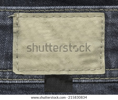 blank leather label on jeans background - stock photo