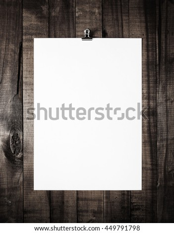 Blank letterhead on vintage wooden table background. White paper poster. Blank paperwork template. Overhead view. - stock photo