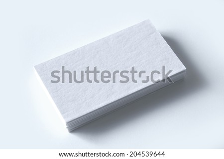 Blank letterpress business cards with clipping path to replace your design - stock photo