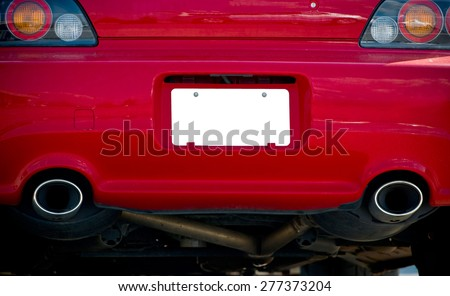 Blank License Plate On Red Car - stock photo