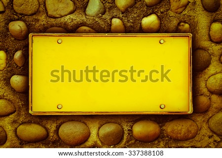 blank license plate on stone in concrete  ,vintage tone - stock photo