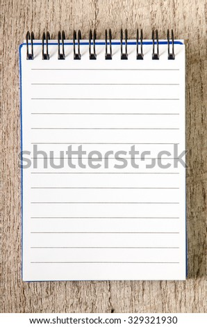 Blank line notepad on wooden table