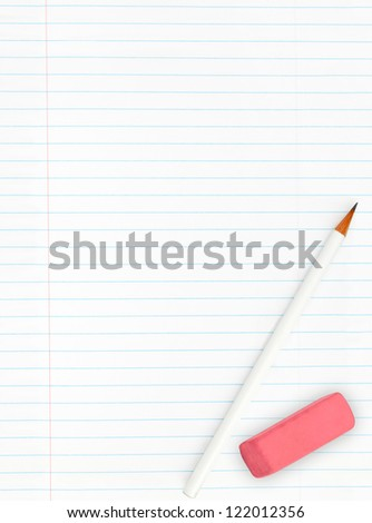 Blank lined sheet of paper from a notebook with pencil and eraser isolated on white background