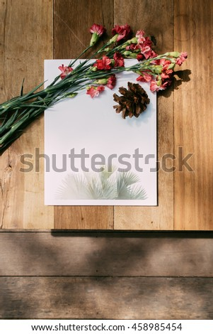 Blank Magazine Cover with Decorative Flower on Wooden Background. Flat Lay Top View Photo