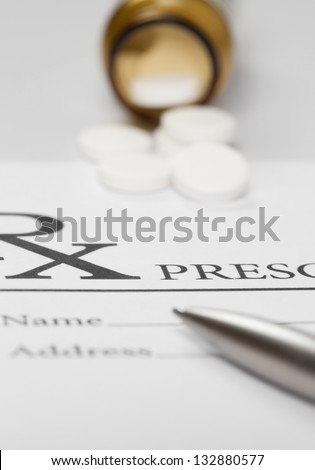 Blank medical prescription with pills on table