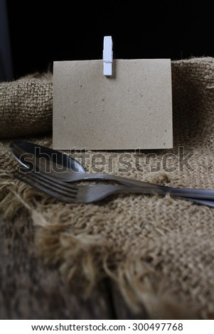 Blank memo with white clip on brown sack textured background - stock photo