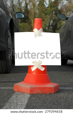 blank message board on a traffic cone - stock photo