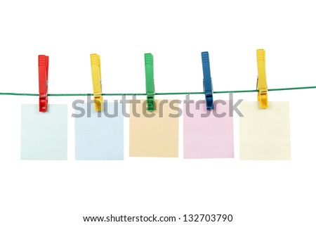Blank message cards hanging with clothespins on washing line